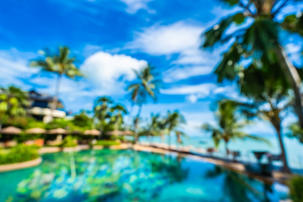 Abstract blur and defocus luxury outdoor swimming pool in hotel resort Free Photo