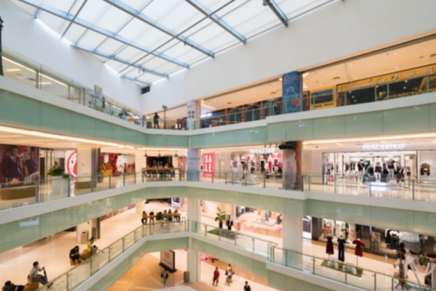 Abstract blur and defocused shopping mall in department store interior Premium Photo
