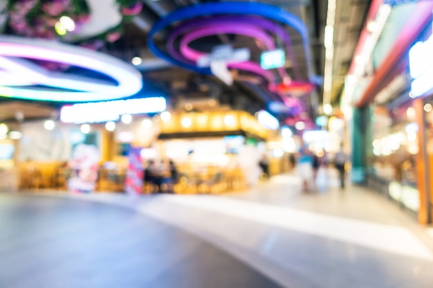 Abstract blur and defocused shopping mall and retail interior of department store, blurred photo background Free Photo