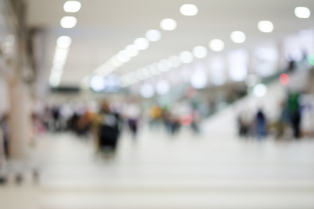 Abstract blur many visitors of the airport terminal Premium Photo