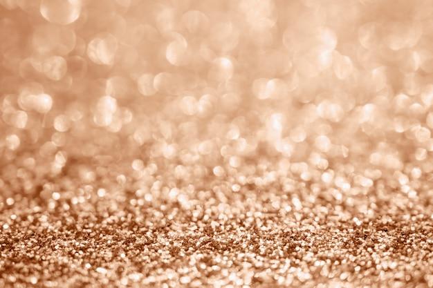 Abstract blur rose gold glitter sparkle defocused bokeh light background Premium Photo