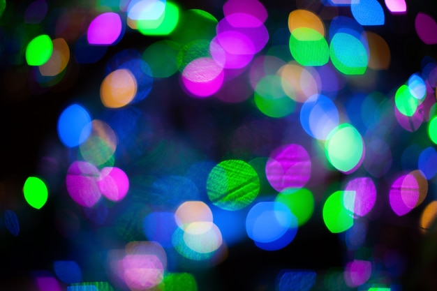 Abstract blurred background with numerous colourful bright festive bokeh. Premium Photo