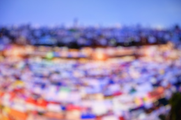 Abstract blurred cityscape building street food market background. Premium Photo