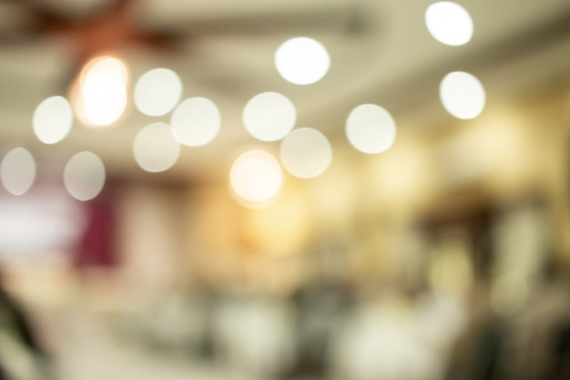 Abstract blurred of conference hall or seminar room photo with light bokeh background. Premium Photo