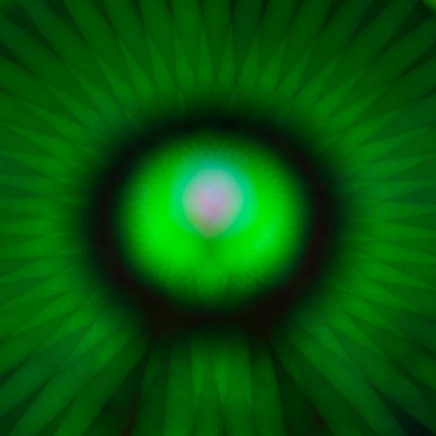Абстрактные размытым зеленым движением неоновые огни чудо-колеса Бесплатные Фотографии