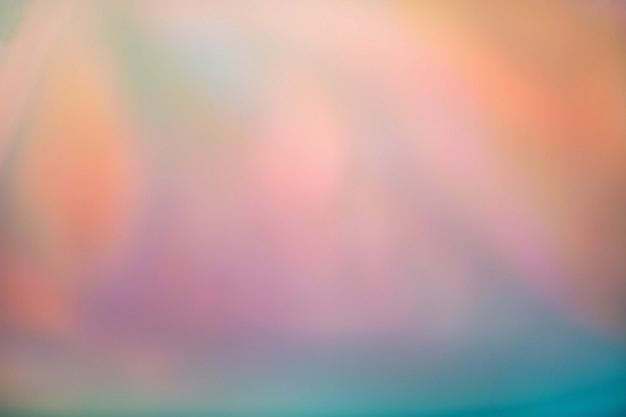 Abstract blurred holographic iridescent foil background. colorful trendy gradient Premium Photo