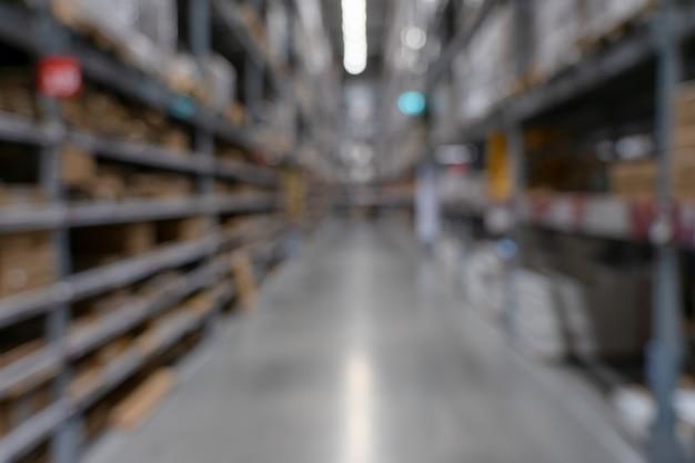 Abstract blurred supermarket view of empty supermarket aisle, defocused blurry Premium Photo