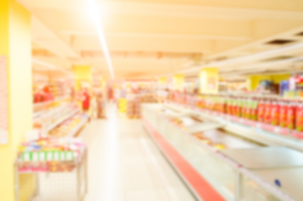 Abstract blurred supermarket with colorful shelves Premium Photo