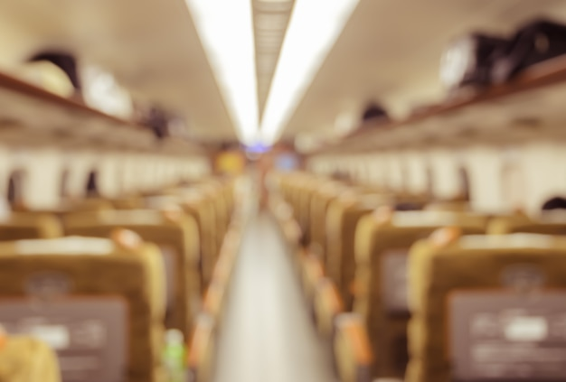 Abstract blurred train interior of a passenger car background. Premium Photo