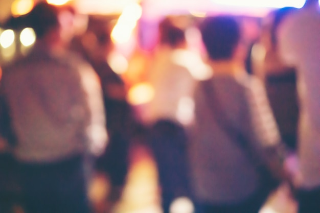 Abstract blurry background, drinkers are dancing in a pub party. Premium Photo