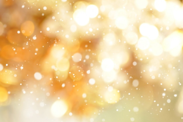 Abstract bokeh gold background with snow Premium Photo