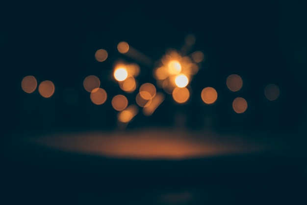 Abstract bokeh lights on dark background Free Photo