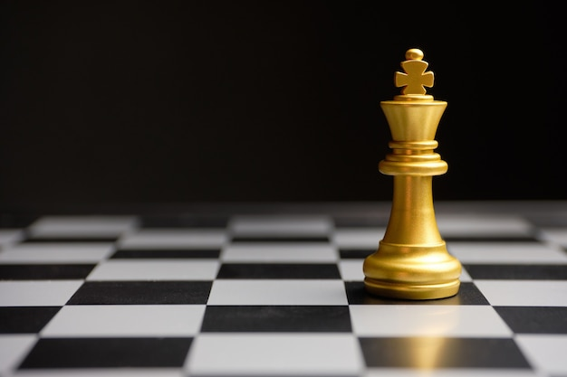 Abstract boss in the form of a chess king copy space. Premium Photo