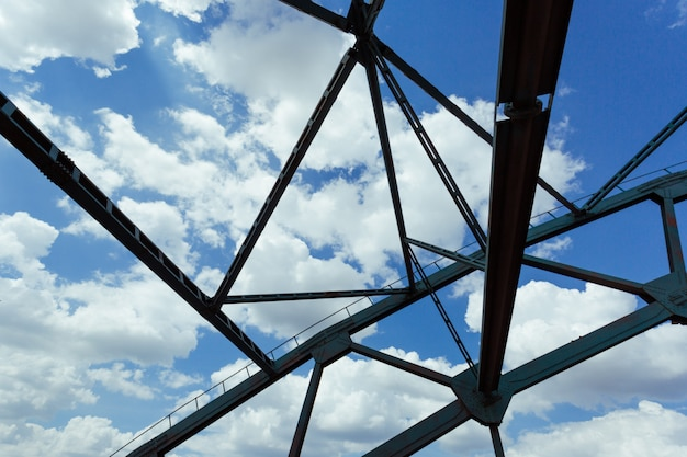Abstract bridge constructions in the background of clouds and blue sky. Premium Photo