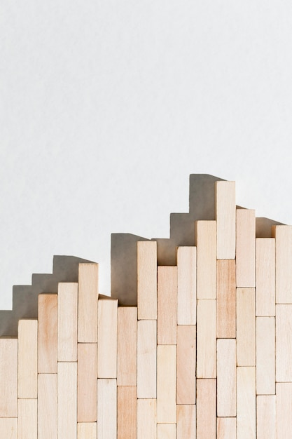 Abstract business graph from wooden pieces Free Photo