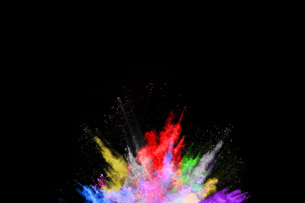 Abstract colored dust explosion on a black background.abstract powder splatted background. Premium Photo