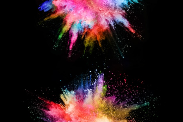 Abstract colored dust explosion on a black background.abstract powder splatted background Premium Photo