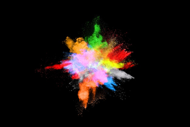 Abstract colored dust explosion on a black background. Premium Photo