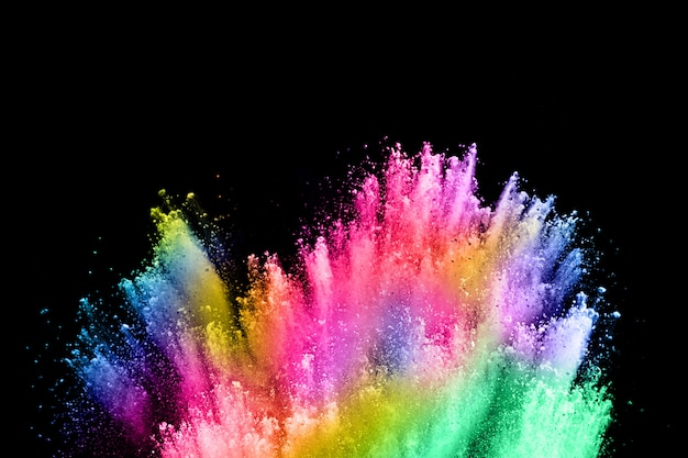 Abstract colored dust explosion on a black. Premium Photo