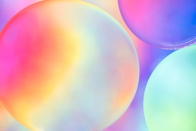 Abstract colorful oil bubbles on blurred background Free Photo
