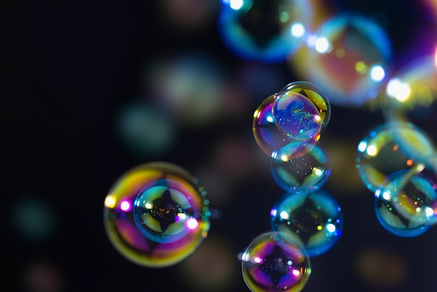 Abstract colors soap bubbles floating in the dark Photo ...