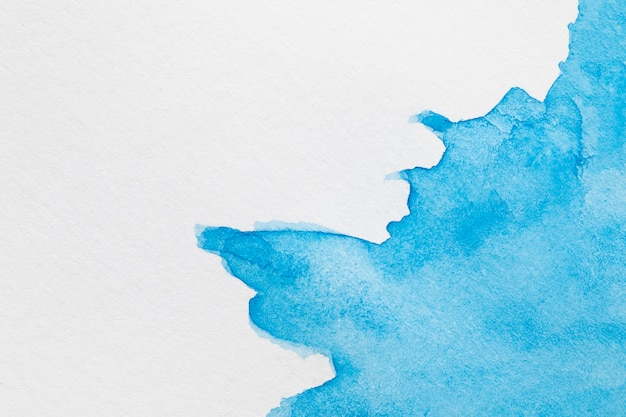 Abstract coloured ink waves on white surface Free Photo