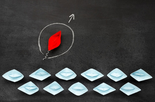 Abstract composition with paper boats on black background Free Photo