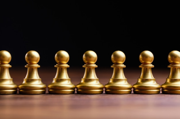 Abstract crowd of people in the form of chess pieces of pawns. Premium Photo
