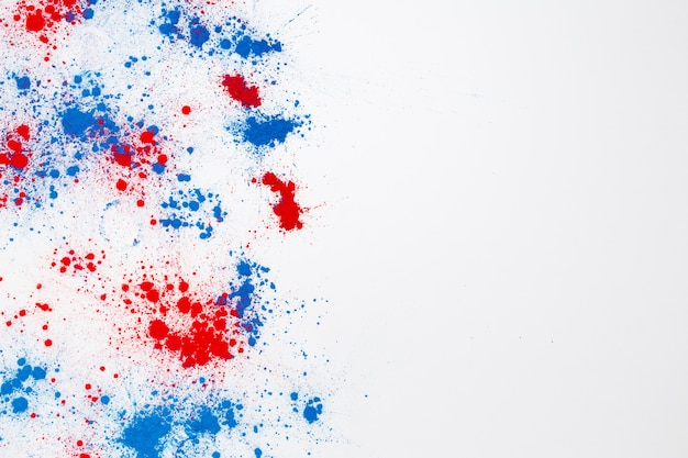 Abstract explosion of red and blue holi color powder with copyspace on the right Free Photo