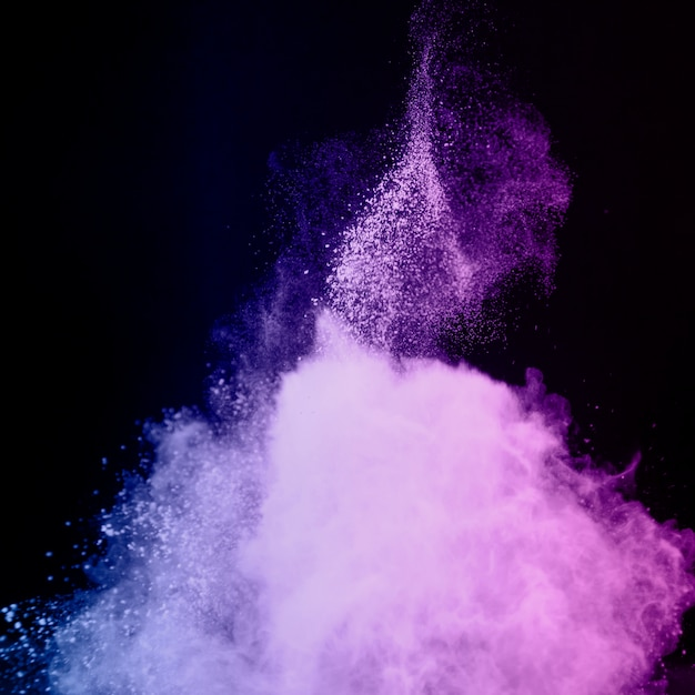 Abstract explosion of violet powder Free Photo