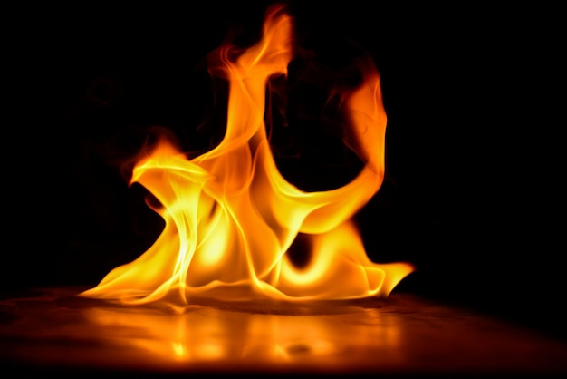 Abstract fire flames isolated on black background Premium Photo