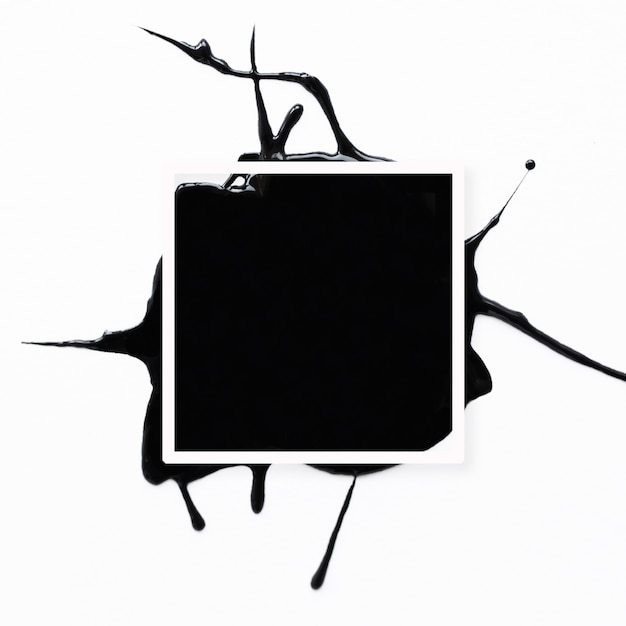 Abstract frame with black splatter on white Free Photo