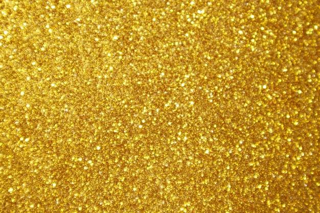 Abstract gold glitter sparkle bokeh light background Premium Photo