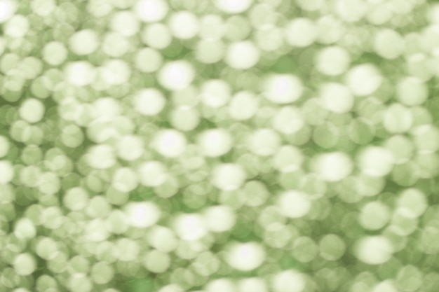 Abstract green blurred bokeh from water drops Premium Photo