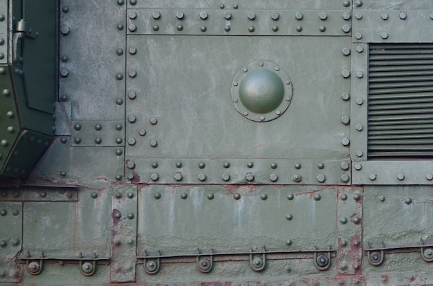 Abstract green industrial metal textured background with rivets and bolts Premium Photo