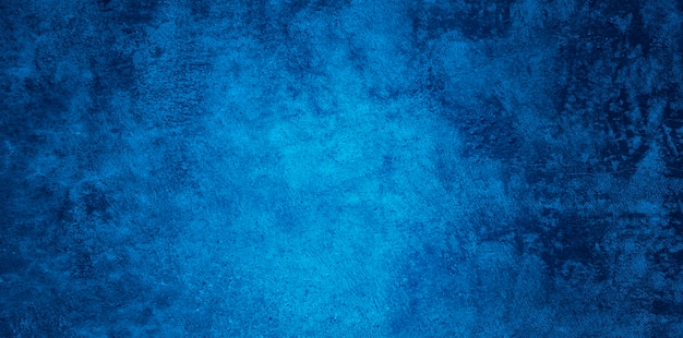 Abstract grunge decorative relief navy blue stucco wall texture. wide angle rough colored background Free Photo