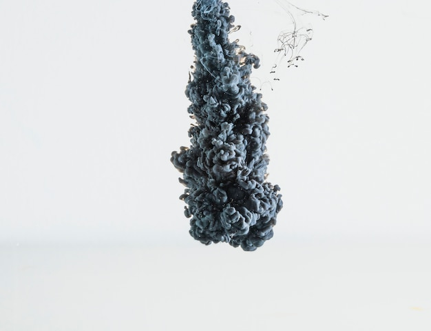 Abstract heavy gray ink drop falling Free Photo