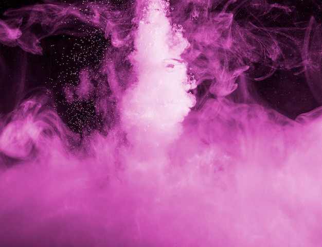 Abstract heavy purple cloud of haze in darkness Free Photo