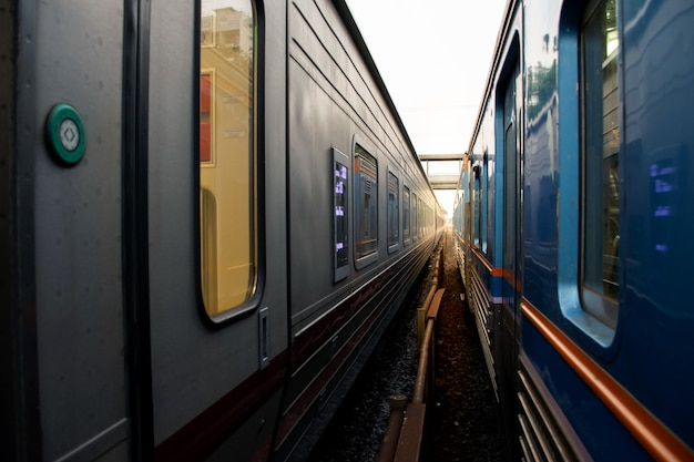 Abstract image of two train  side by side with rail Premium Photo