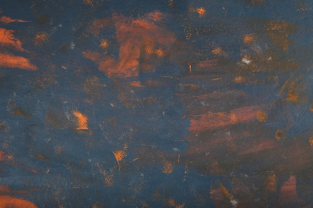 Abstract marble art with blue and orange paint. Free Photo