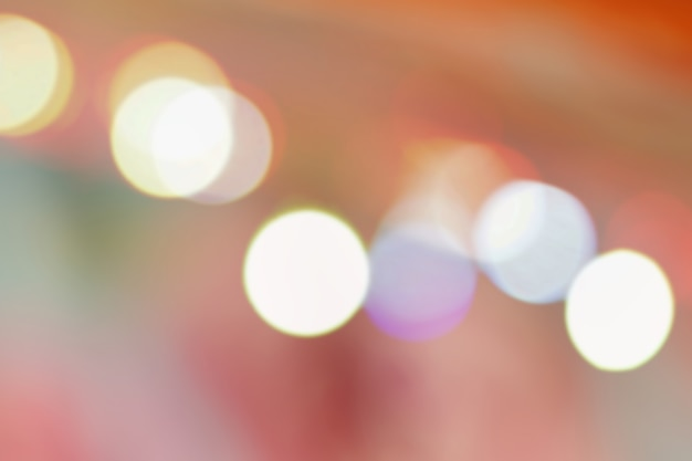 Abstract night street light and bokeh in pink pastel color, defocussed background. Premium Photo