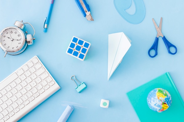 Abstract office supplies on blue Free Photo