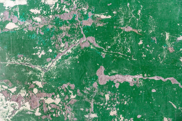Abstract old and abandoned crack epoxy green floor texture. Premium Photo