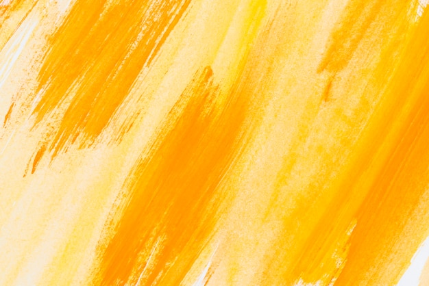 Abstract painted yellow watercolor background on paper texture Free Photo