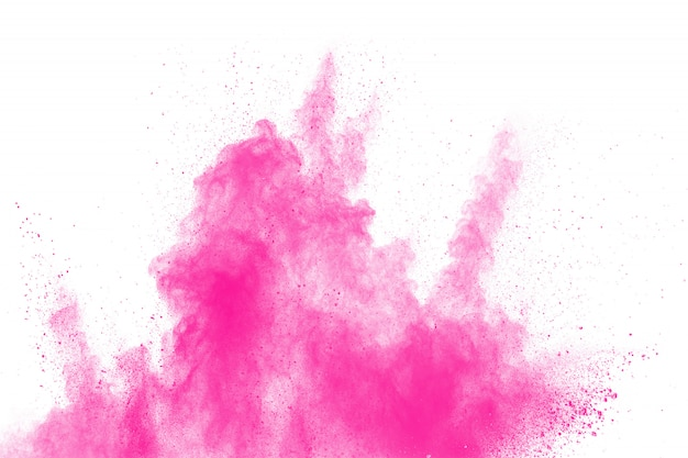 Abstract pink dust explosion on white background. Premium Photo