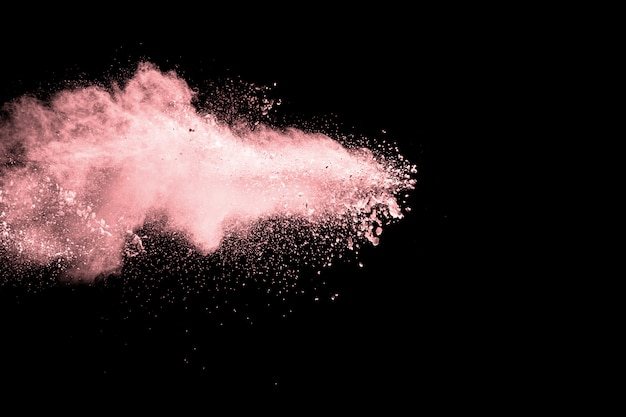 Abstract pink powder explosion on  black background Premium Photo