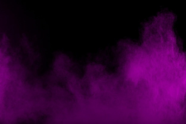 Abstract purple smoke flowed in black background.dramatic purple smoke clouds. Premium Photo