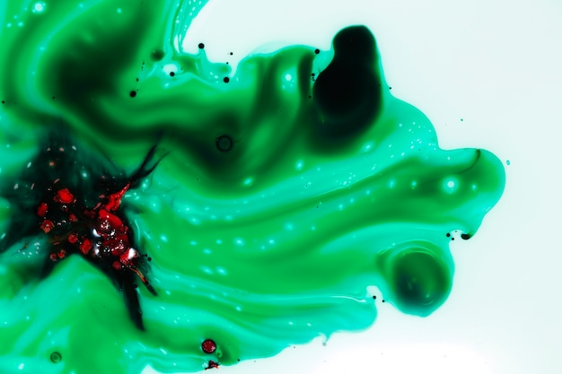 Abstract red figure on green slime Free Photo