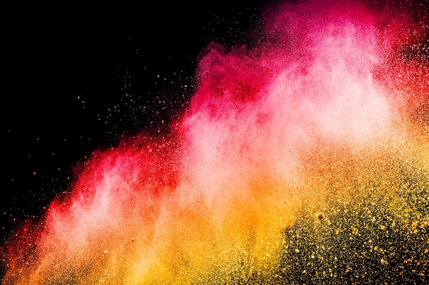 Abstract red yellow dust explosion on  black background. Premium Photo