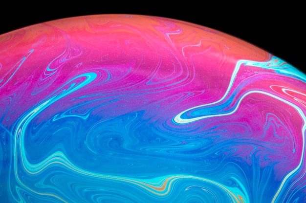 Abstract saturated soap bubble on black background Free Photo